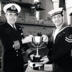 Photograph Bob Harvey receiving Peregrine Trophy from the Captain of Illustrious