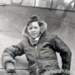 Photograph Peter Lyns in Flying gear leaning on ac wing