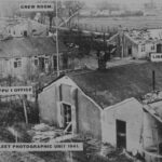 Photograph Remarks/People  Involve.  Fleet Photographic Unit? 1941 with Bomb Damage This  could be Film Production Unit No1