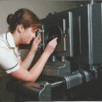 Photograph. Tina Ford (Now du Feu) using Horizontal enlarger at Tipner