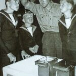 Photograph Photographer with T Tanks showing Sea Cadets? Film in hanger