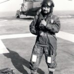 Photograph Ash Amniwala in Flying gear on Flight deck of Hermes