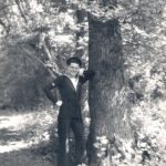 Frank Bulger standing by tree