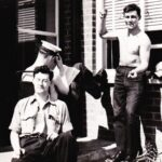 , Photograph Bill McRobbie, left, Ray Pogson, wearing hat, and a shirt-less Art Brockman make the most of the warm spring sunshine whilst forming part of the 1963 Easter Leave retard party