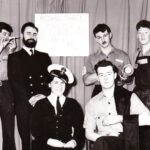 , Photograph Ready for all contingencies...Paul Yockney, left, Mac McCarthy, Art Brockman, Ray Pogson, wren Marian Davies from Photographic Interpretation and Bill McRobbie form the 1963 Easter Leave retard party.