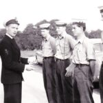 , Photograph Instructor Taff Eyers points out the fundamental aspects of press photography to No 6 Course Phot III trainees Bill McRobbie, left, Ray Pogson, Duncan Reid and Mike Lay at RNSOP Ford in July 1958. Alex Jamieson took the photograph.