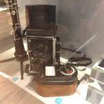 , Photograph Mamiya camera and Weston Master exposure meter on display at the exhibition for the 100th anniversary of the formation of the WRNS