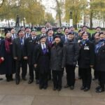 Photograph Cenotaph marchers at the Fleet Air Arm memorial on the embankment after the march L-R   : Richard Thompson, Ric Burch, Julie Richardson, Danny du Feu, Maurice Brailey, Ian Wrightson (part hidden), Paul Hopley, Bob Stanyard, Catherine Kelly, Stuart Wood, Phil Everett, Ray Whitehouse, Joan Roberts, Wilf Francis, Ian Hooper, Maggie Pugh, Roger Forbes,   Angela McLeod, Glynis Shaw, Alan Ferguson,   June   Smith, Mike Gilbert, Janet Pierpoint, Vince Richards, Crissie Proudly (who marches with the WRNS) Ship/Place/Originator   The  Embankment ,Date/ Date Range  10-11-2019