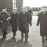 Photograph Walking to work in Lossie's wooden phot section  L-R Rainer Gunthart (German photographer), Jock Hetherington, Gordon @bogie Knight, Mike Keeling